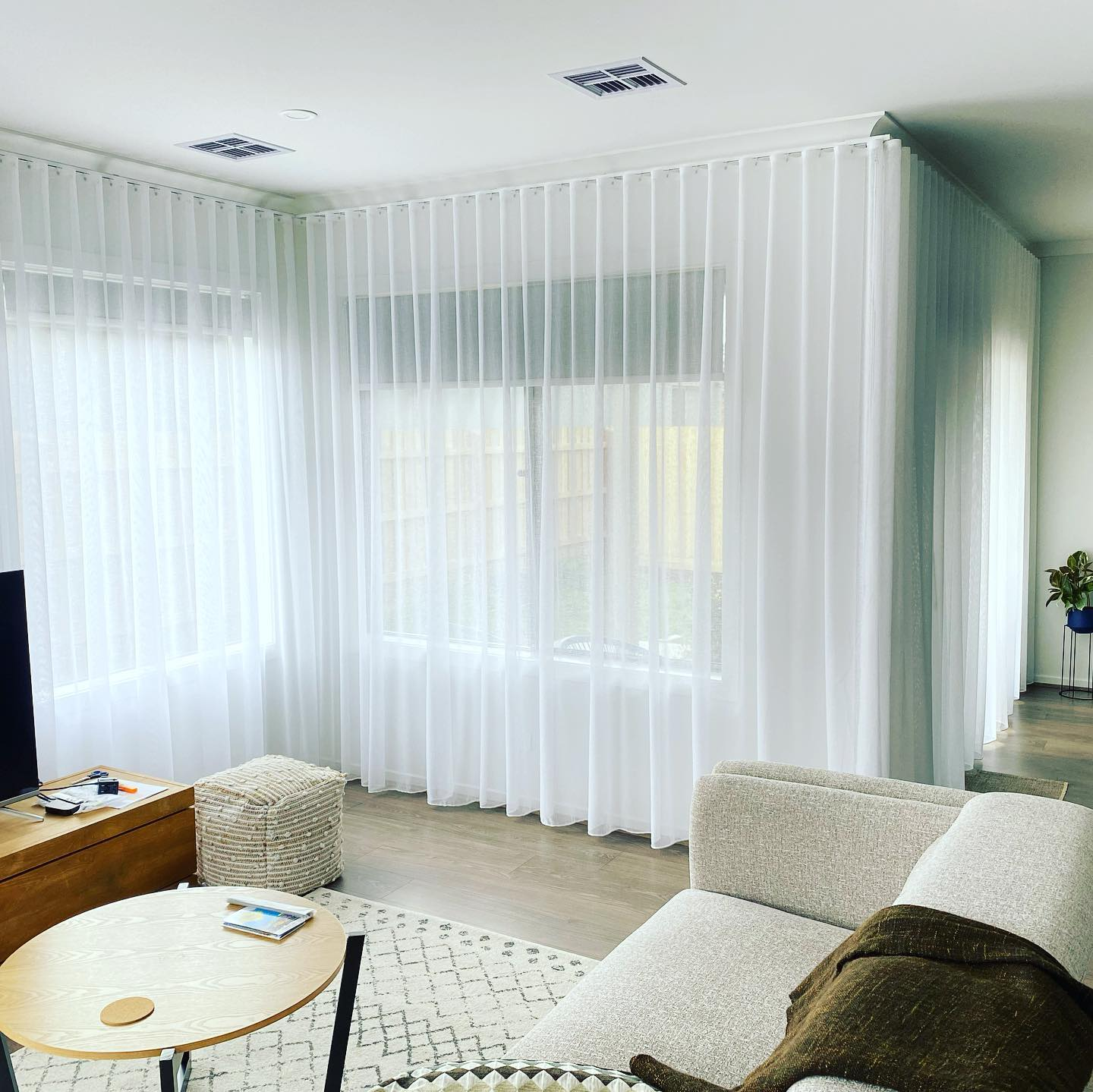 colour sheer curtains installed in Aintree
